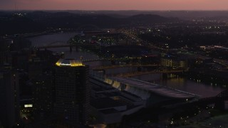 AX108_135 - 4K stock footage aerial video of PNC Park and bridges spanning the Allegheny River, Downtown Pittsburgh, twilight