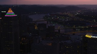 AX108_141 - 4K stock footage aerial video of PNC Park, Heinz Field and bridges spanning Allegheny River, Pittsburgh, Pennsylvania, twilight