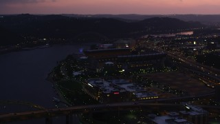 AX108_144 - 4K stock footage aerial video approaching Heinz Field, Pittsburgh, Pennsylvania, twilight