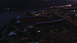 AX108_145 - 4K stock footage aerial video approaching Heinz Field, Pittsburgh, Pennsylvania, twilight