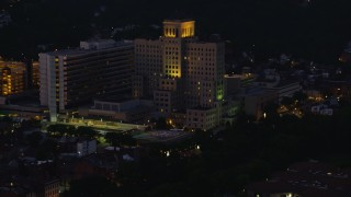 AX108_147 - 4K stock footage aerial video approaching Allegheny General Hospital, Pittsburgh, Pennsylvania, night
