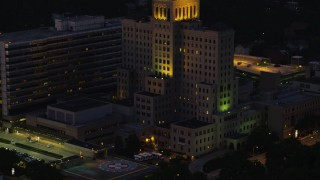 AX108_148 - 4K stock footage aerial video flying by Allegheny General Hospital, Pittsburgh, Pennsylvania, night