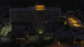 AX108_149 - 4K stock footage aerial video orbiting Allegheny General Hospital, Pittsburgh, Pennsylvania, night