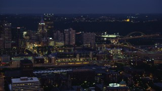 AX108_151 - 4K stock footage aerial video passing skyscrapers, Downtown Pittsburgh, Pennsylvania, night