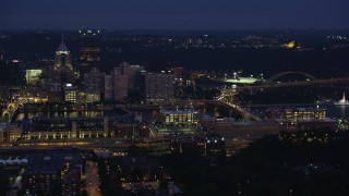 AX108_152 - 4K stock footage aerial video flying by Downtown Pittsburgh revealing Point State Park, Pennsylvania, night