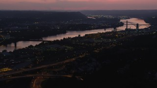 AX108_154 - 4K stock footage aerial video approaching Western State Penitentiary along the river, Pittsburgh, Pennsylvania, twilight