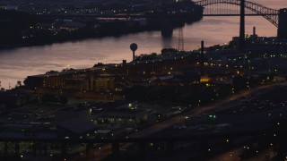 AX108_155 - 4K stock footage aerial video of Western State Penitentiary along the river, Pittsburgh, Pennsylvania, twilight