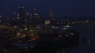 AX108_163 - 4K stock footage aerial video of Downtown Pittsburgh skyscrapers from Rivers Casino, Pennsylvania, night