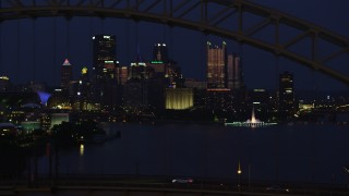 AX108_165 - 4K stock footage aerial video of Downtown Pittsburgh skyscrapers and Point State Park; night
