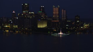AX108_166 - 4K stock footage aerial video of Downtown Pittsburgh skyscrapers and Point State Park, Pennsylvania, night