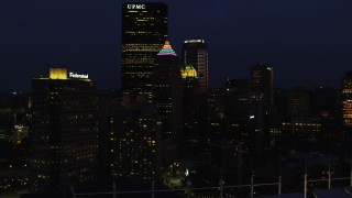 AX108_174 - 4K stock footage aerial video flying by Gulf Tower and U.S. Steel Tower, Pittsburgh, Pennsylvania, night
