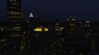 AX108_175 - 4K stock footage aerial video of Gulf Tower, Federated Tower and skyscrapers, Pittsburgh, Pennsylvania, night