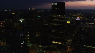 AX108_178 - 4K stock footage aerial video approaching BNY Mellon Center, U.S. Steel Tower and tilt down, Pittsburgh, Pennsylvania, twilight