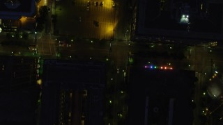 AX108_181 - 4K stock footage aerial video of a bird's eye of Forbes Avenue and city buildings, Downtown Pittsburgh, Pennsylvania, night