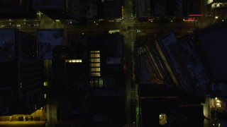 AX108_182 - 4K stock footage aerial video of a bird's eye of Forbes Avenue and city buildings, Downtown Pittsburgh, Pennsylvania, night