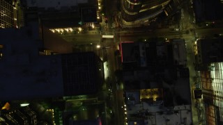 AX108_188 - 4K stock footage aerial video of a bird's eye of city streets and buildings, Downtown Pittsburgh, Pennsylvania, night