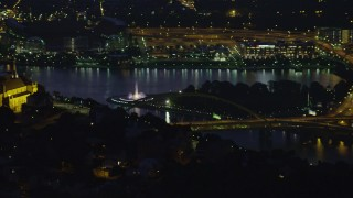 AX108_197 - 4K stock footage aerial video of Point State Park Fountain, Downtown Pittsburgh, Pennsylvania, night