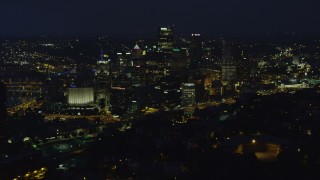 AX108_202 - 4K stock footage aerial video of skyscrapers seen from Monongahela River, Downtown Pittsburgh, Pennsylvania, night