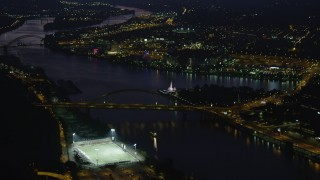 AX108_209 - 4K stock footage aerial video approaching Point State Park, Downtown Pittsburgh, night