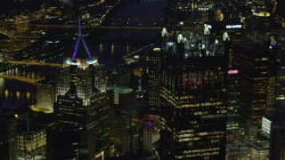 AX108_211 - 4K stock footage aerial video orbiting top of PPG Place, Downtown Pittsburgh, Pennsylvania, night