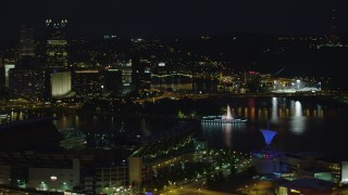 AX108_216 - 4K stock footage aerial video of Point State Park from Heinz Field, Downtown Pittsburgh, night