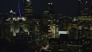 AX108_221 - 4K stock footage aerial video flying by Fifth Avenue Place, Downtown Pittsburgh, night