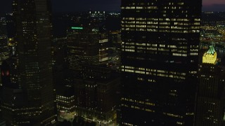 AX108_226 - 4K stock footage aerial video flying by skyscrapers, Downtown Pittsburgh, Pennsylvania, night