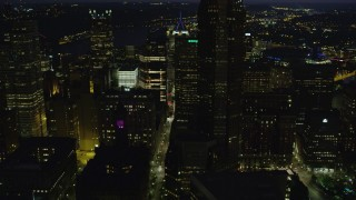 AX108_227 - 4K stock footage aerial video flying by city streets and skyscrapers, Downtown Pittsburgh, Pennsylvania, night