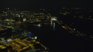 AX108_233 - 4K stock footage aerial video of Point State Park and Downtown Pittsburgh, Pennsylvania, night
