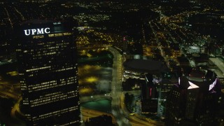 AX108_239 - 4K stock footage aerial video following Centre Avenue, Downtown Pittsburgh, Pennsylvania, night