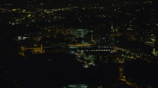 AX108_241 - 4K stock footage aerial video approaching VA Pittsburgh Healthcare System, Pittsburgh, night