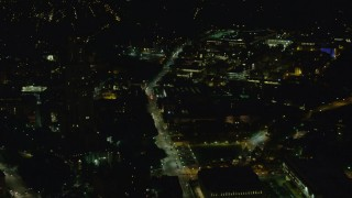 AX108_244 - 4K stock footage aerial video approaching Carnegie Mellon University, Pittsburgh, Pennsylvania, night
