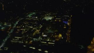 AX108_245 - 4K stock footage aerial video approaching Carnegie Mellon University, Pittsburgh, Pennsylvania, night