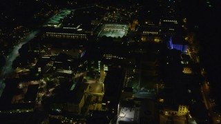 AX108_246 - 4K stock footage aerial video tilting down on the Carnegie Mellon University campus, Pittsburgh, Pennsylvania, night