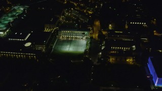 AX108_247 - 4K stock footage aerial video flying over Carnegie Mellon University campus buildings, Pittsburgh, night
