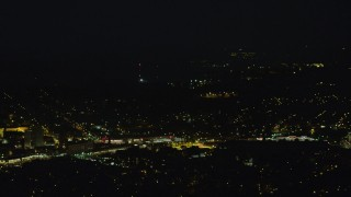 AX108_248 - 4K stock footage aerial video of residential neighborhoods, Pittsburgh, Pennsylvania, night