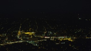 AX108_249 - 4K stock footage aerial video flying by residential neighborhoods, Pittsburgh, Pennsylvania, night