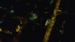AX108_255 - 4K stock footage aerial video of a bird's eye of city streets, Pittsburgh Pennsylvania, night