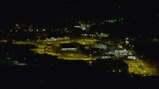 AX108_262 - 4K stock footage aerial video flying by a shopping center, Penn Hills, Pennsylvania, night