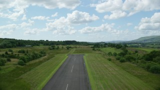 AX109_001 - 6K stock footage aerial video of liftoff from Cumbernauld Airport, Scotland