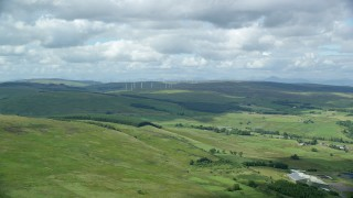 AX109_005 - 6K stock footage aerial video of windmills and farms, Denny, Scotland