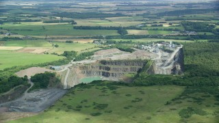 AX109_008 - 6K stock footage aerial video flyby quarry and farmland, Denny, Scotland