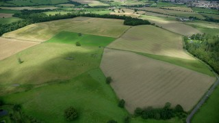 AX109_011 - 6K stock footage aerial video fly over farm fields in Stirling, Scotland