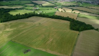 AX109_012 - 6K stock footage aerial video of green fields, farms and trees, Stirling, Scotland
