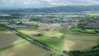AX109_013 - 6K aerial stock footage video of flying over farms toward rural homes, Stirling, Scotland