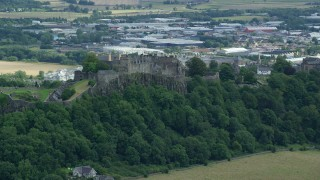 AX109_021 - 6K stock footage aerial video of Stirling Castle on a hill in Scotland