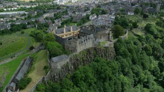 AX109_025 - 6K stock footage aerial video approach and tilt to castle grounds of Stirling Castle, Scotland