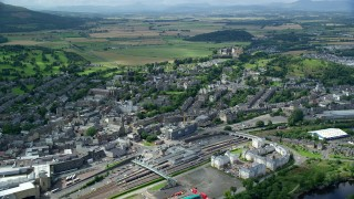 AX109_028 - 6K stock footage aerial video of Stirling Castle and apartment buildings, Scotland