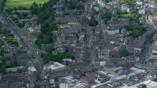 AX109_030 - 6K stock footage aerial video of panning across apartment buildings in Stirling, Scotland