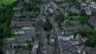 AX109_032 - 6K stock footage aerial video of apartment buildings and shops in Stirling, Scotland